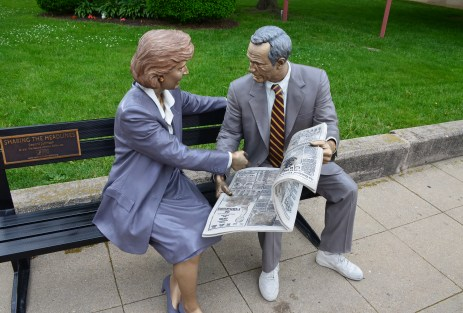Reading a newspaper on the square in Crown Point, Indiana