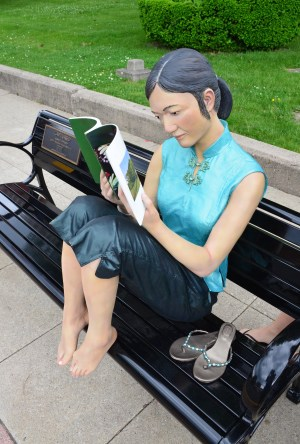 Reading a book on the square in Crown Point, Indiana