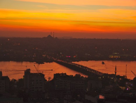 Looking across the Golden Horn at sunset from the top of the Galata Tower in Beyoğlu, Istanbul, Turkey
