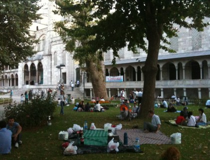 Picnic outside the Blue Mosque during Ramadan at Sultanahmet in Istanbul, Turkey
