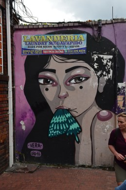 Woman with a butterfly in her mouth on the Bogotá Graffiti Tour in Bogotá, Colombia