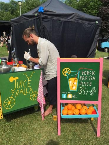 Henrik pressing juice at his Juice Tralla stand.