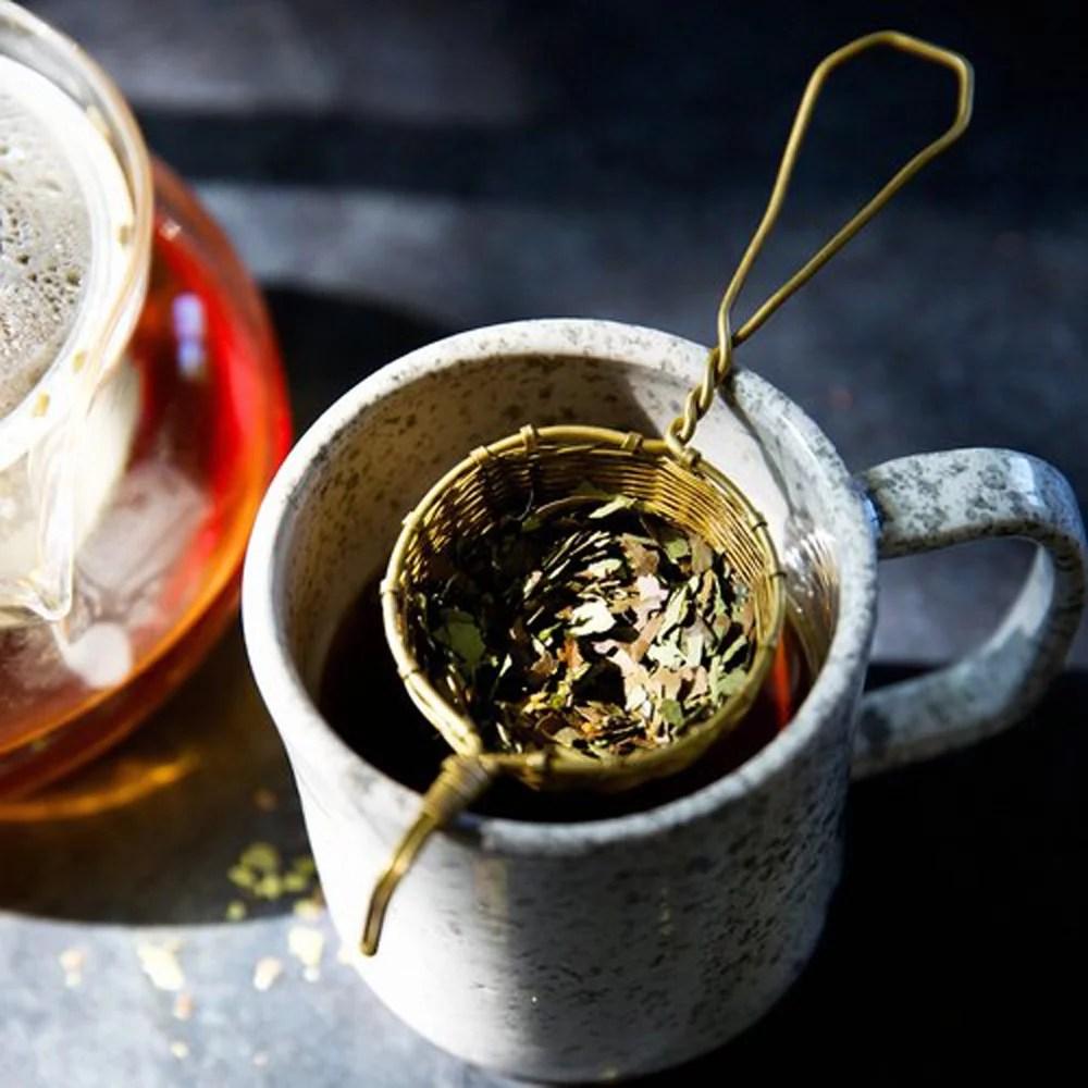 Strain tea leaves or tea bag & re-steep!