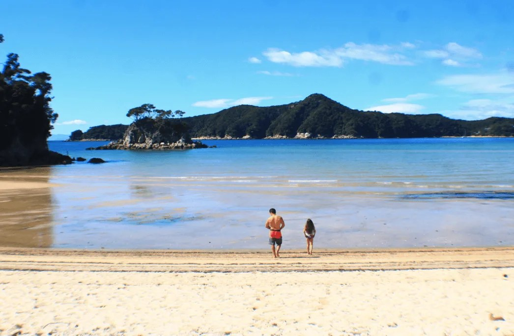 Swimming at Torrent Bay before low tide crossing, How to backpack Abel Tasman: 3-4 day Abel Tasman Backpacking Itinerary