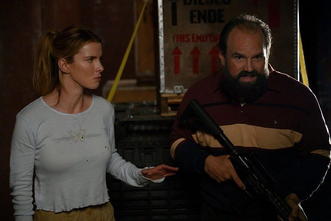 Betty Gilpin and Ethan Suplee in The Hunt