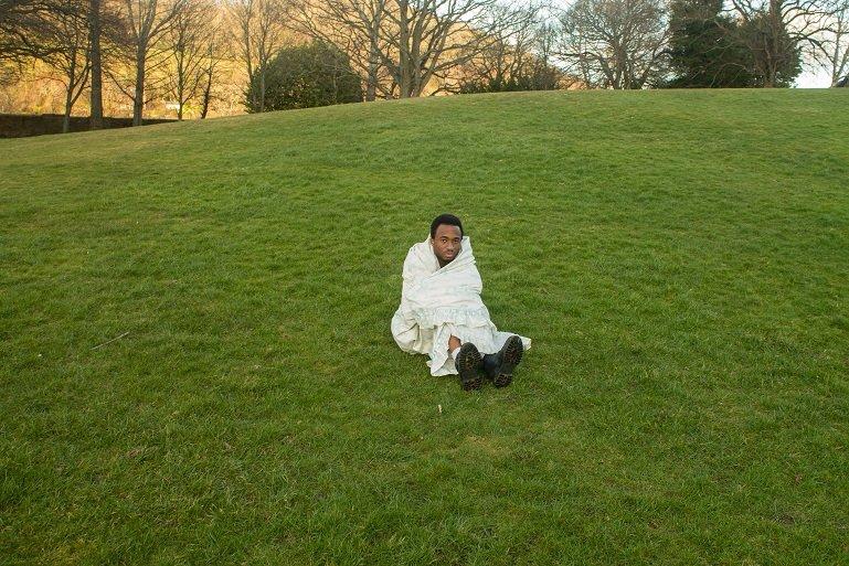 Man sitting on grass