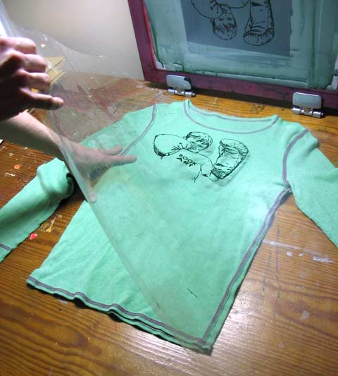 b3696f81e Remove the acetate (just move it out of the way, don't detach it from the  table!) and lower the screen onto your shirt or paper. Print the image by  holding ...