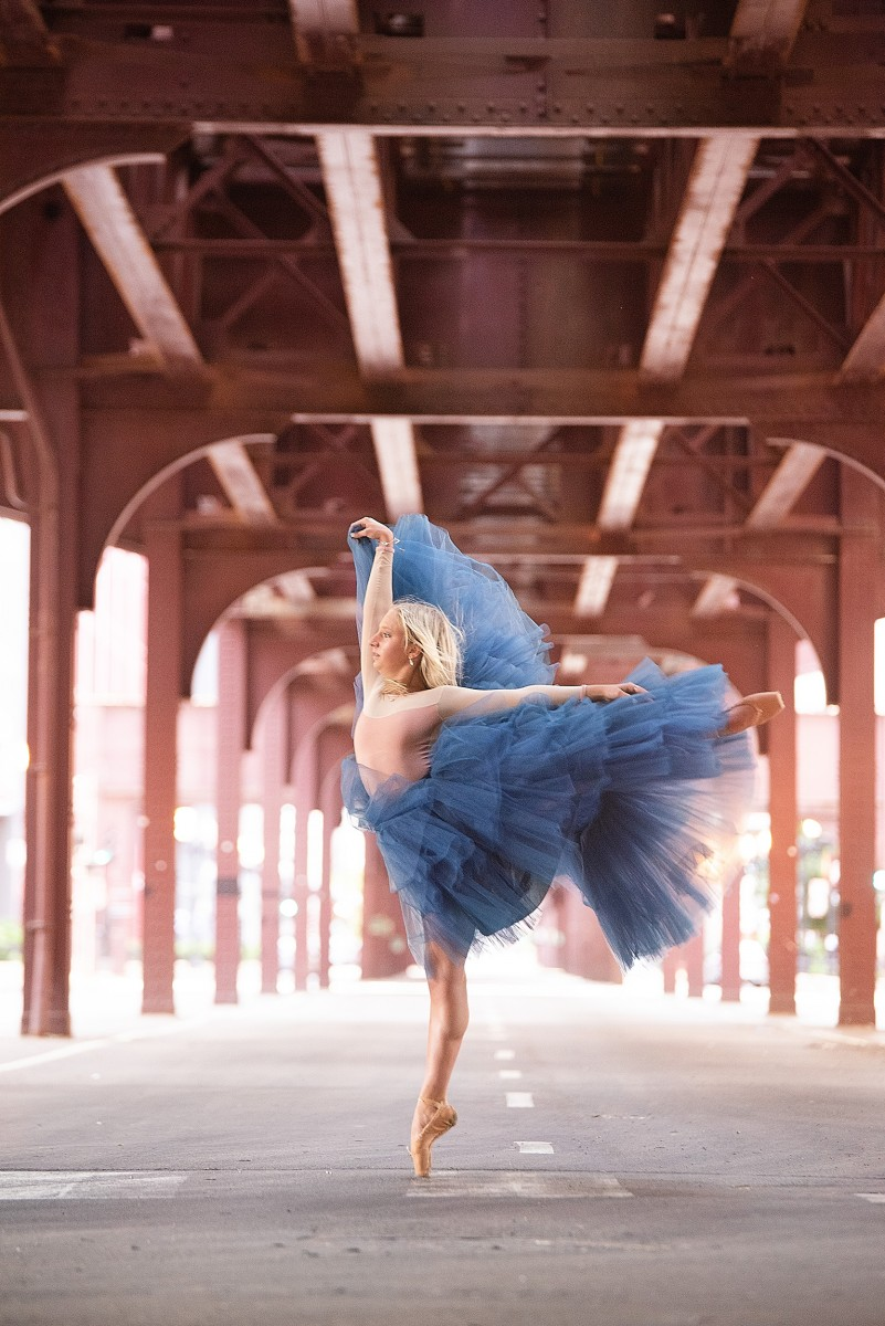Ava Bernardi on pointe under Train on Wabash St Chicago