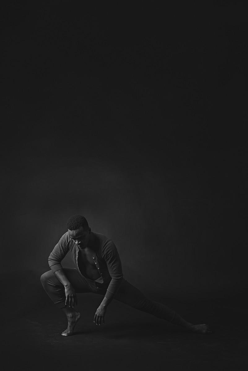 Maleek Washington deep though black and white photo