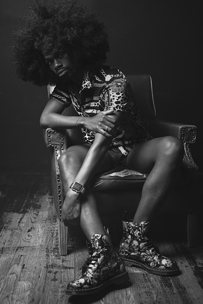 Otis Flexcii Sundarii wearin floral boots patterned shirt and natural hair afro