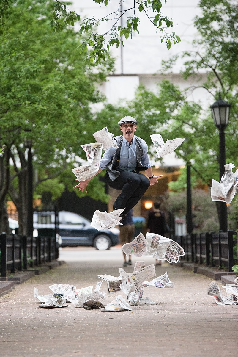 Riccardo Battaglia tossing newspapers Newsies Chicago Magnificent Mile