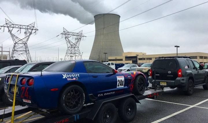Nissan Xterra towing corvette racecar on trailer