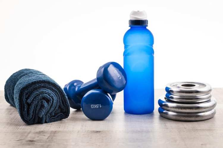 Towel, weights, water bottle and barbell weights