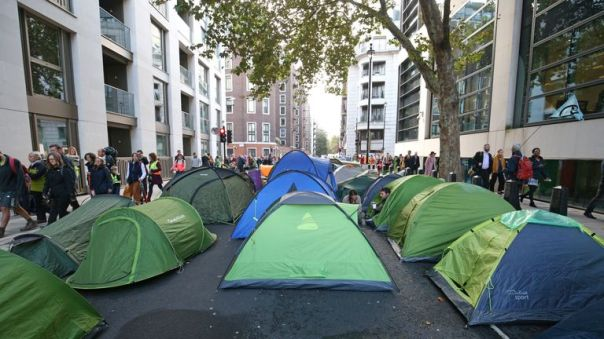 Extinction Rebellion (XR) protesters who have set up camp on Horseferry Road and Marsham Street in Westminster, London.