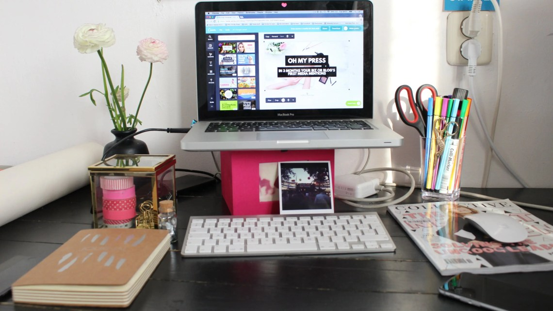 Behind the scenes of a blogger and business owner freelancer office desk with Collective Magazine and Apple Macbook