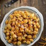 italian struffoli are deep fried morsels of dough that are bathed in warm honey and adorned with sprinkles and some orange zest. Delicious!