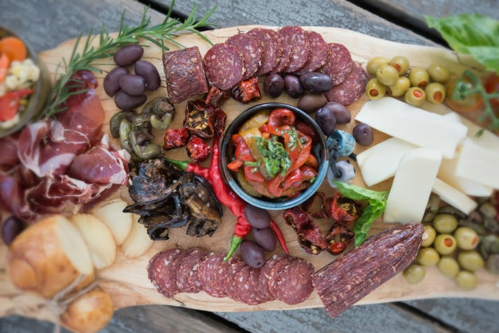 charcuterie board using carnivore club meats and alche design wood board