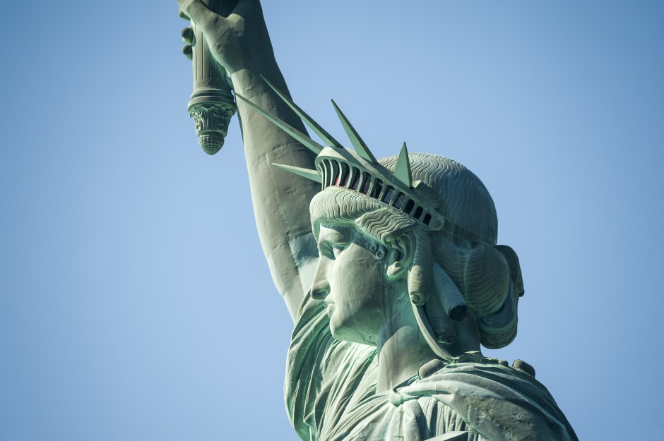 Statue of Liberty on Hudson River in NYC