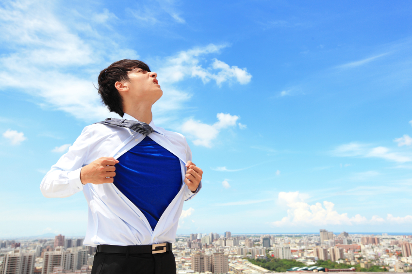 Business man showing superhero suit