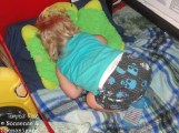 Toddler sleeping curled up with butt in air