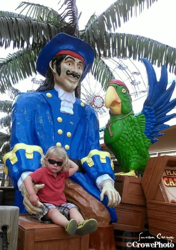 toddler with pirate and parrot