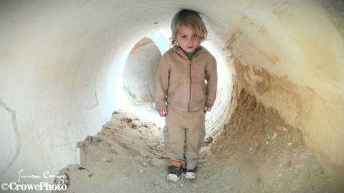 toddler in tunnel