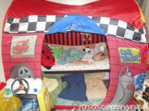 toddler bed and sleeping toddler inside tent