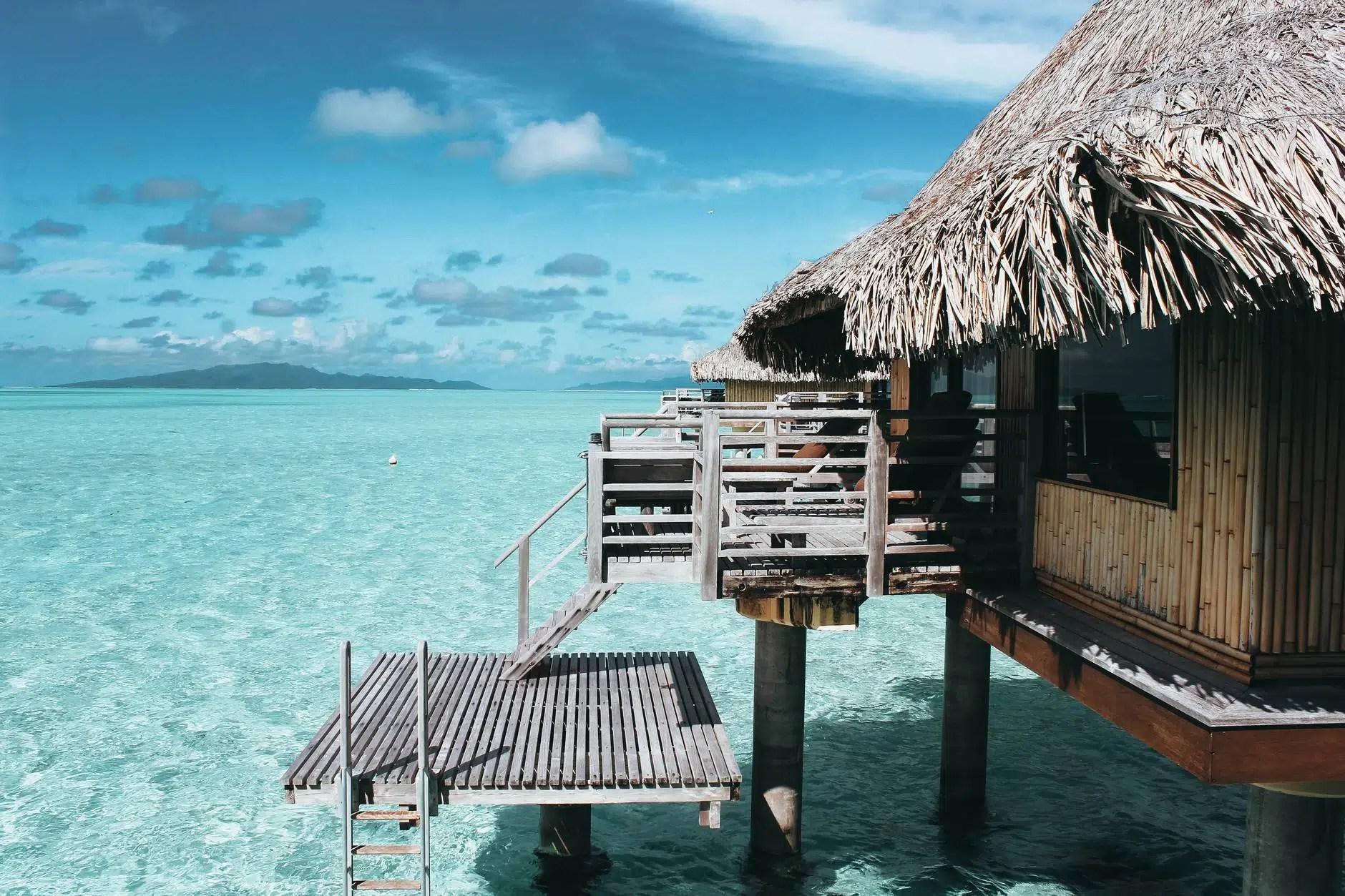brown nipa hut on body of water