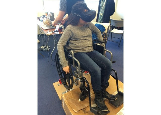 A person in a wheelchair using VR.