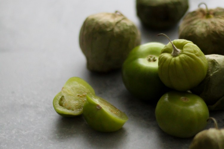Green tomatillos with dramatic lighting