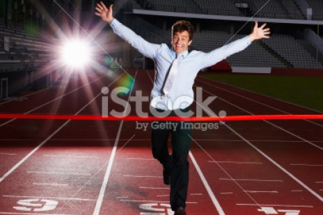stock-photo-14946030-cheerful-middle-aged-business-man-about-to-win-a-race