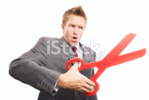 stock-photo-15135547-businessman-cutting-with-big-pair-of-red-scissors-snip-1