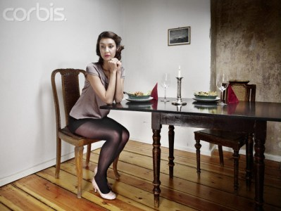 Woman waiting at the dinner table
