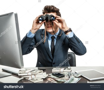 stock-photo-serious-male-viewing-through-binoculars-photos-of-modern-businessman-at-the-workplace-303570818