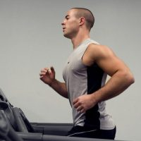 15397-a-healthy-young-man-running-on-a-treadmill-in-a-gym-pv (1)