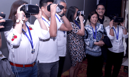 QC Councilors try a Virtual Reality viewer