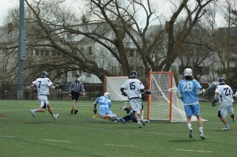 Chris Schoenhut's diving goal helped spark a Tufts first half run! (Photo Credit: Matt Noonan for NoontimeSports.com)