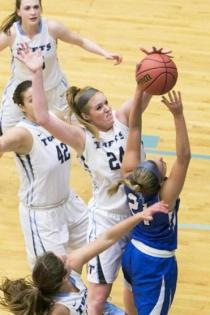 Tufts University junior Michaela North netted a three-pointer with 49 seconds left to lift the eighth ranked Jumbos past No. 2 Amherst on Saturday. (Photo Credit: Boston Globe)
