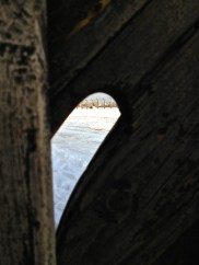 Birkenau view through key hole from bathroom building