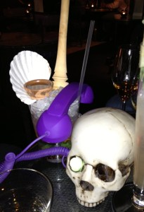 A posh drink with a purple skull phone from Artesian.