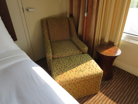 Please make yourself small and comfortable in this bed.