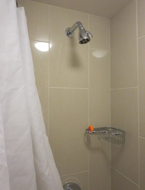 PLASTIC SHOWER. Look at that light shine off the curtain.