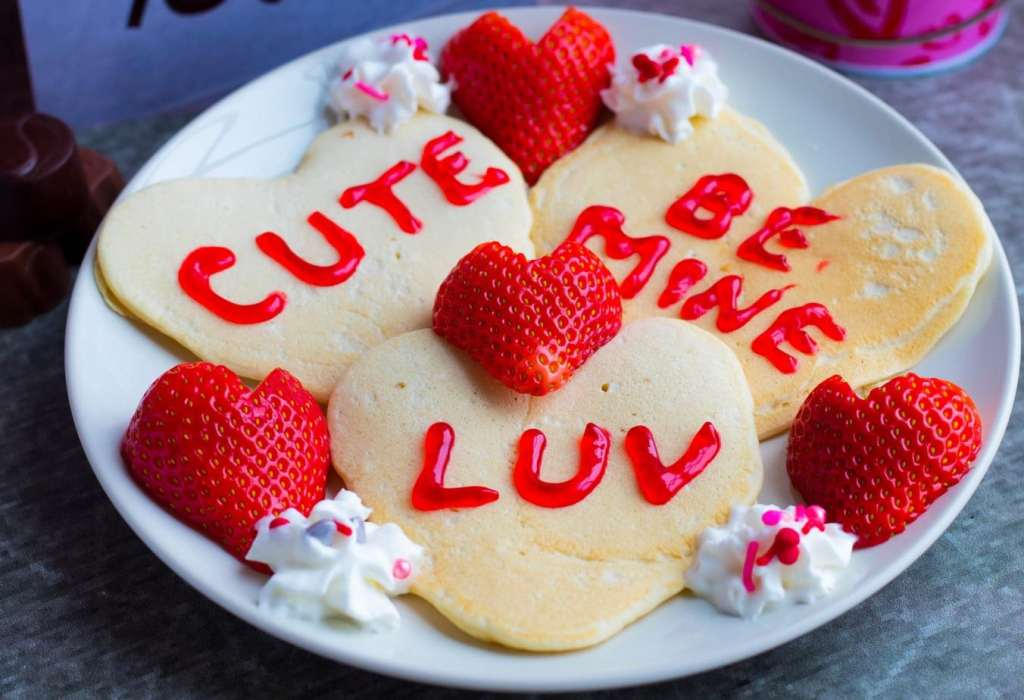 Make these adorable, easy-to-make Conversation Heart Pancakes with Heart Strawberries for you family this Valentine's Day and say I LOVE YOU!