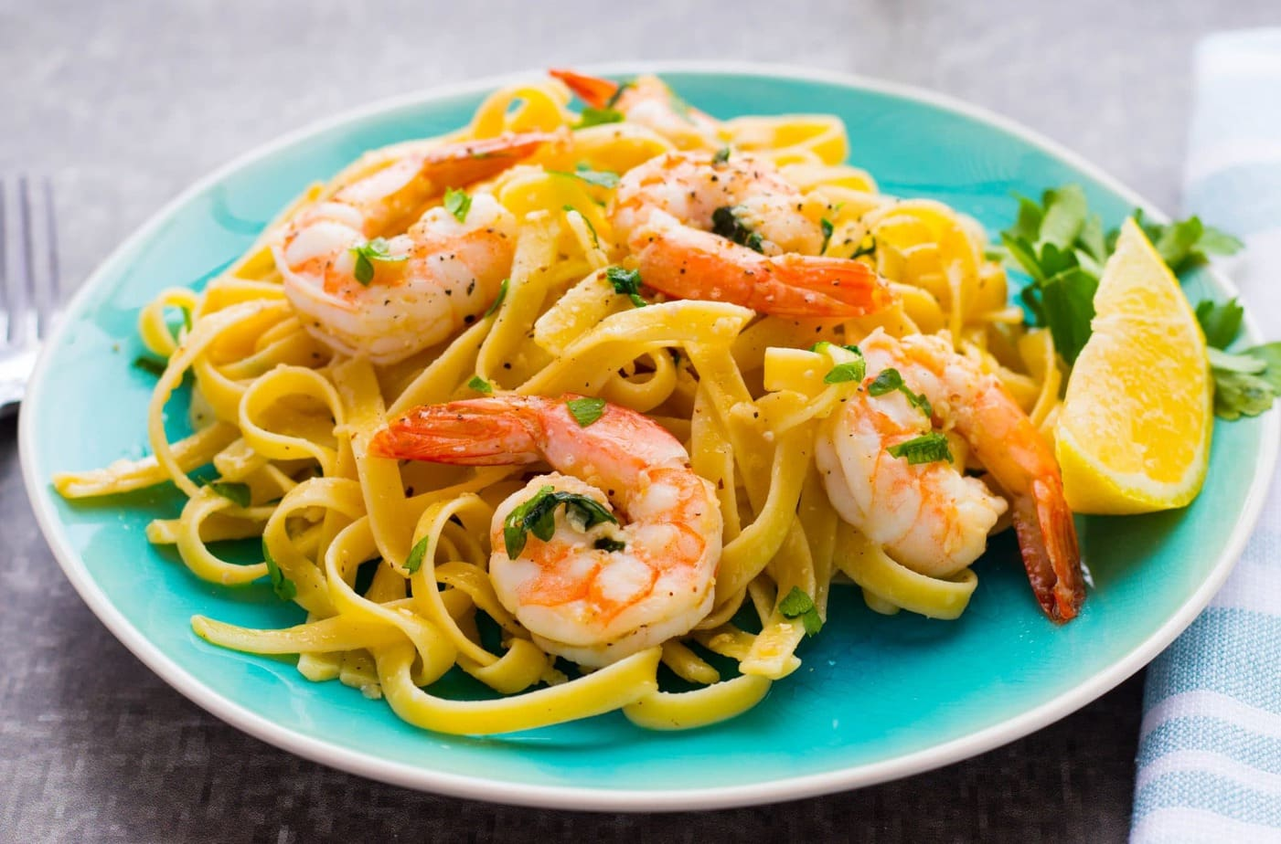 Easy Shrimp Scampi Fettuccine is ready in 20 min with only a few ingredients! It's full of garlic flavor and the perfect weeknight meal!