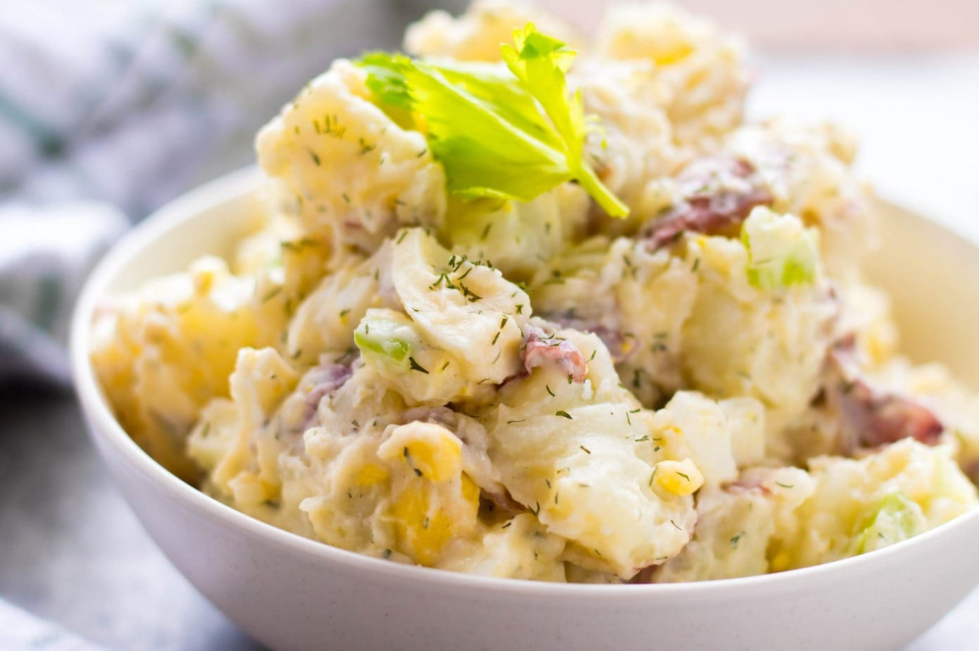 The Best Creamy Red Skin Dill Potato Salad recipe uses steamed potatoes for silky perfect potatoes every time. A great potluck potato salad for BBQs!