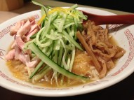The cold yuzu ramen is topped with ham, cucumber, picked bamboo shoots and pieces of raw yuzu fruit.