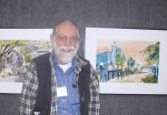 Master Artist David Peterson with two of his works on exhibit at SFAC