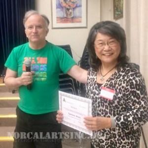 Mary Wang-Steele receives an NCA Artist Standing Program certificate from program chair Paul Dessau