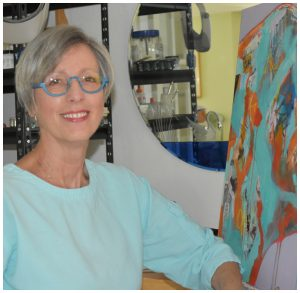 Judy Knott, NCA Master Artist, at her easel