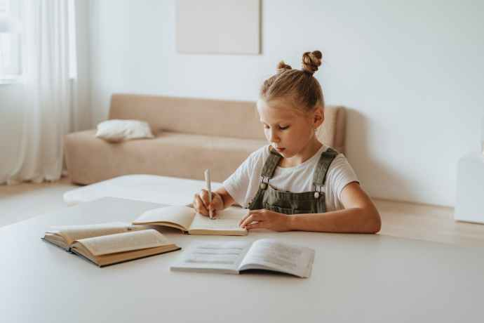 little girl doing her homework